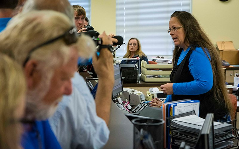 Rowan County Clerk Kim Davis, right, argues with David Moore and David Ernold, after they were denied a marriage license at the Rowan County Courthouse in Morehead on September 1, 2015. Photo courtesy of USA Today, via The (Louisville, Ky.) Courier-Journal, photo by Tim Webb
