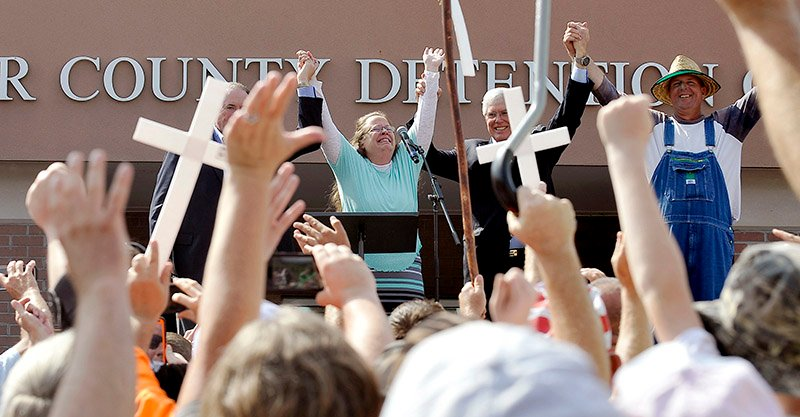 Rowan County Clerk Kim Davis, flanked by Republic presidential candidate Mike Huckabee, left, Attorney Mathew Staver, second right, and her husband Joe Davis, right, celebrates her release from the Carter County Detention center in Grayson, Kentucky on September 8, 2015. U.S. Photo courtesy of REUTERS/Chris Tilley *Editors: This photo may only be republished with RNS-MARSHALL-COLUMN, originally transmitted on September 10, 2015.
