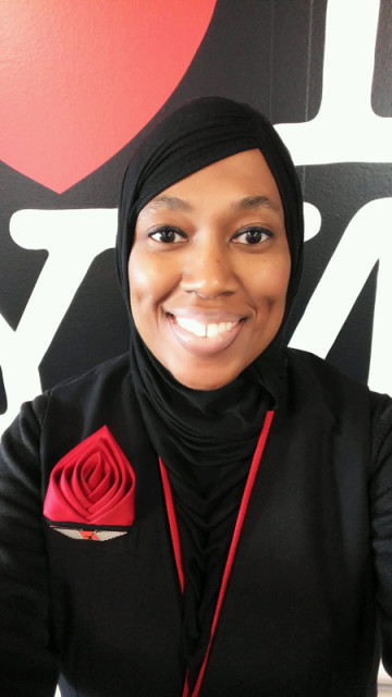 Charee Stanley, a Muslim flight attendant, says ExpressJet suspended her for refusing to serve alcohol, which is against her religious beliefs. Photo: courtesy of CAIR-Michigan, via USA Today