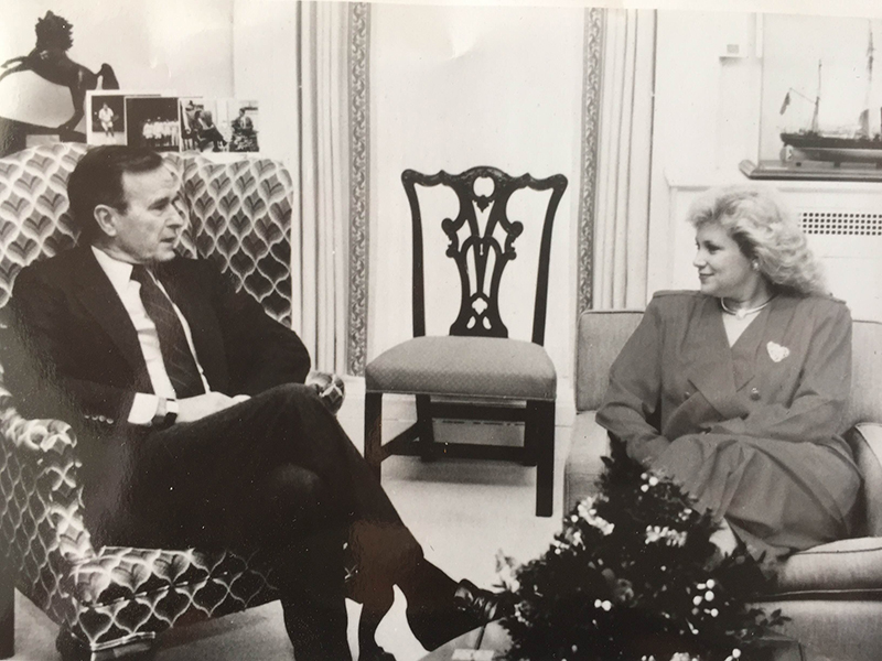 Sandi Patty and Preident George H.W. Bush during a meeting at the White House, date unknow. Photo courtesy of Mike Atkins Entertainment