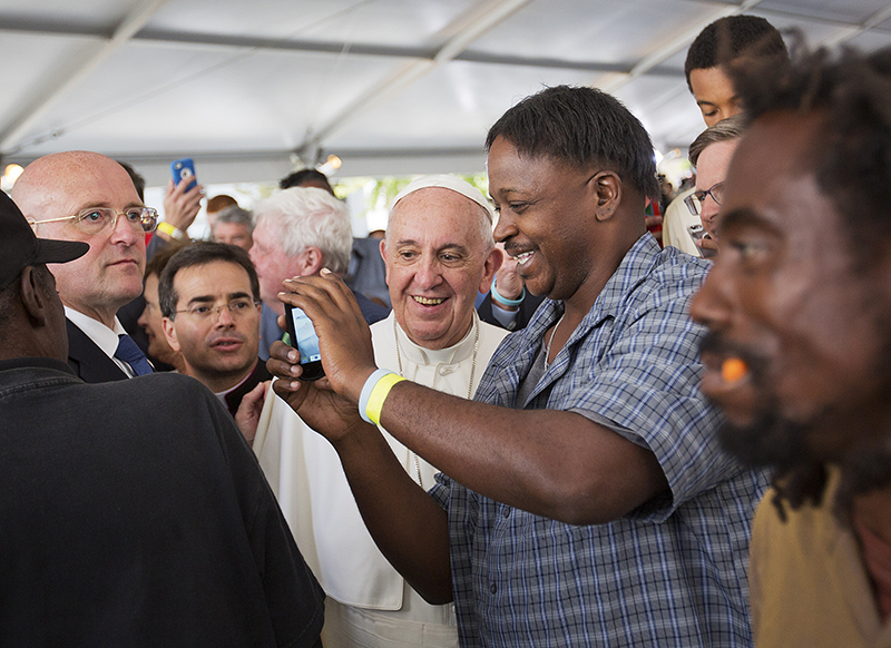 Pope Francis visits with homeless who are served meals by Catholic charities, in Washington, DC, on September 24, 2015. Photo courtesy of REUTERS/Pool *Editors: This photo may only be republished with RNS-POPE-HOMELESS, originally transmitted on Sept. 24, 2015.
