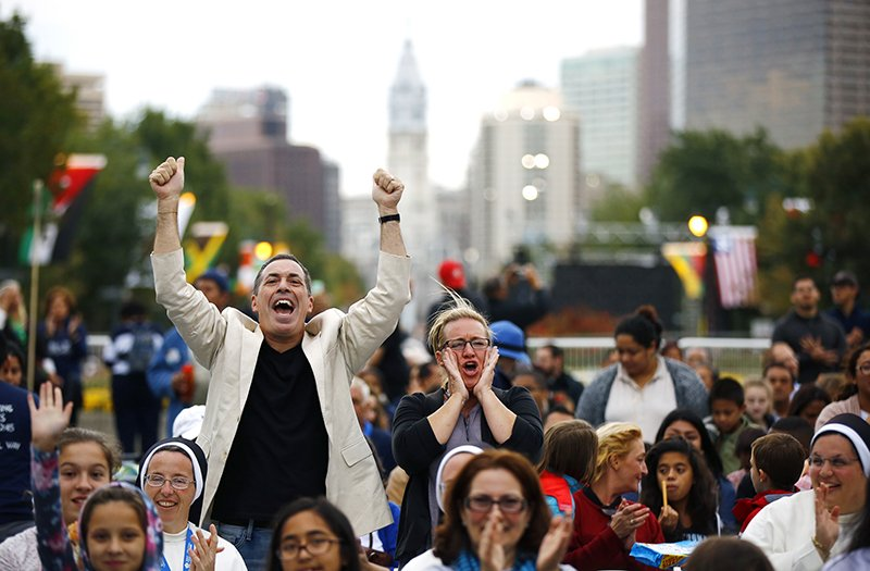 People cheer as they wait for Pope Francis in Philadelphia on September 26, 2015. Photo courtesy of REUTERS/POOL *Editors: This photo may only be republished with RNS-POPE-IMMIGRATION, originally transmitted on Sept. 26, 2015.