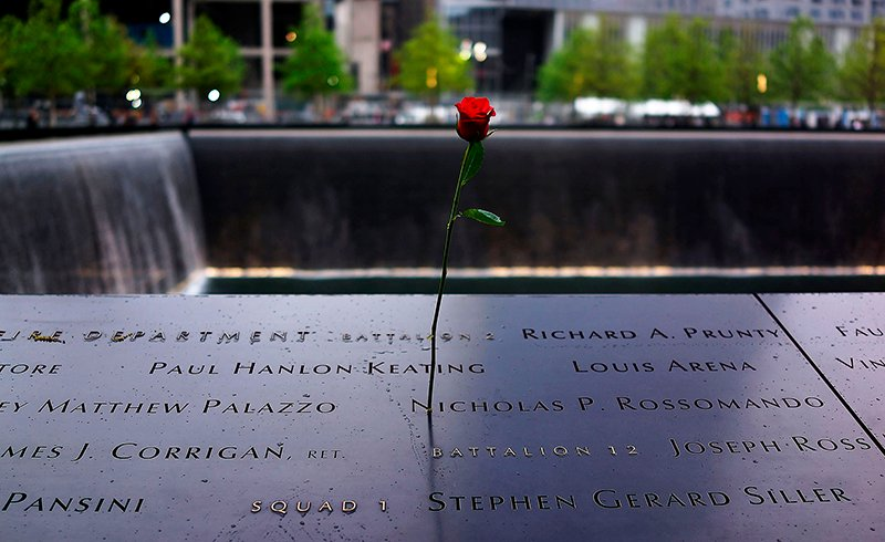 A rose is placed on a name engraved along the South reflecting pool at the Ground Zero memorial site during the dedication ceremony of the National September 11 Memorial Museum in New York on May 15, 2014. Photo courtesy of REUTERS/Spencer Platt/Pool *Editors: This photo may only be republished with RNS-POPE-INTERFAITH, originally transmitted on September 17, 2015.