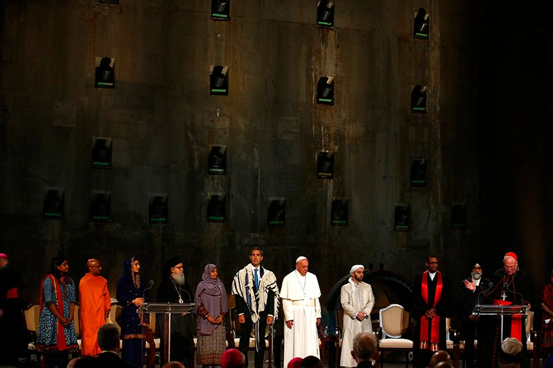 Cardinal Timothy Dolan, far right, speaks as Pope Francis stands with Jewish and Muslim leaders as he visits the museum to the September 11, 2001 attacks in New York, on September 25, 2015. Photo courtesy of REUTERS/Tony Gentile *Editors: This photo may only be republished with RNS-POPE-INTERFAITH, originally transmitted on Sept. 25, 2015.