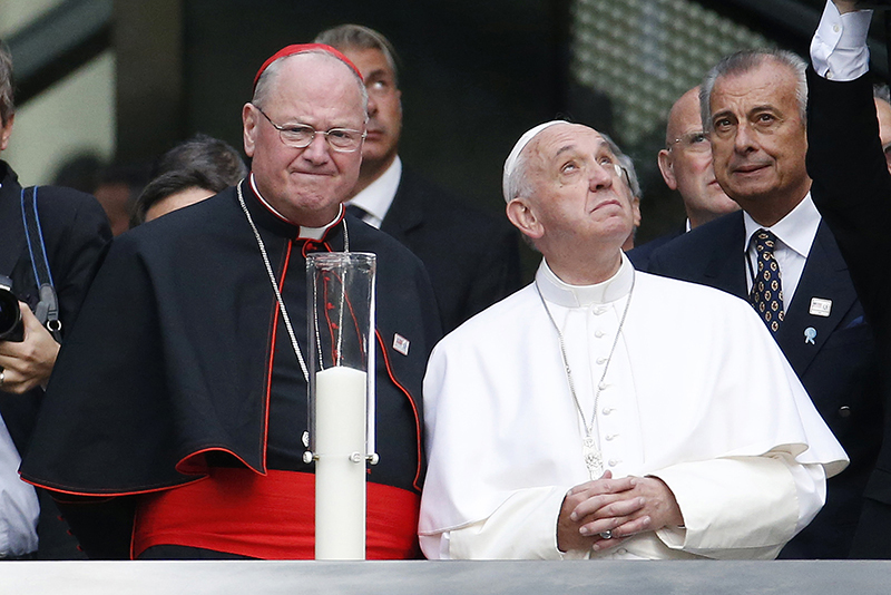 Pope Francis looks up at buildings surrounding the 9/11 Memorial while visiting the South Pool at the World Trade Center in New York, September 25, 2015. Pope Francis is on a five-day trip to the United States. REUTERS/Julio Cortez/AP/POOL - RTX1SGZL