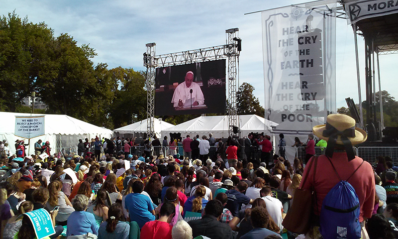 A crowd of thousands gathered on the National Mall to watch Pope Francis addresses Congress on Sept. 24, 2015. Religion News Service photo by Adelle M. Banks