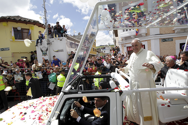 Pope Francis waves to the faithful while riding on a Jeep popemobile in El Quinche, Ecuador, on July 8, 2015. Photo courtesy of REUTERS/Guillermo Granja *Editors: This photo may only be republished with RNS-POPE-MOBILE, originally transmitted on September 2, 2015.