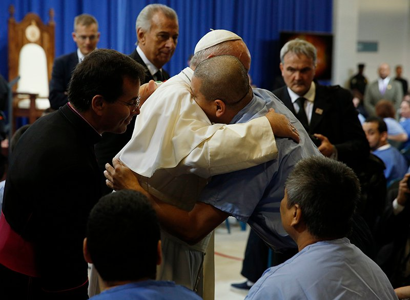 Pope Francis embraces an inmate as he meets with prisoners at Curran-Fromhold Correctional Facility in Philadelphia, on September 27, 2015. Photo courtesy of REUTERS/Jonathan Ernst *Editors: This photo may only be republished with RNS-POPE-PRISONERS, originally transmitted on Sept. 27, 2015.