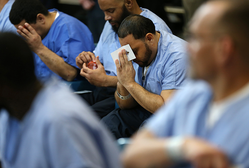 Inmate David Hernandez, 39, of North Philadelphia prays during the Pope Francis visit at the Curran-Fromhold Correction Facility in Philadelphia, Pennsylvania on September 27, 2015. Photo courtesy of REUTERS/David Maialetti/Pool *Editors: This photo may only be republished with RNS-POPE-PRISONERS, originally transmitted on Sept. 27, 2015.
