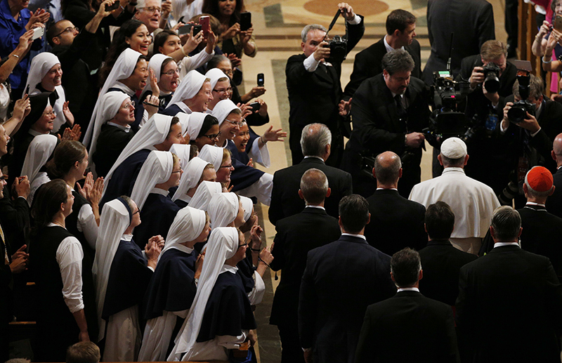 Pope Francis is greeted inside the Basilica of the National Shrine of the Immaculate Conception as he arrives for a Canonization Mass for Friar Junipero Serra in Washington on September 23, 2015. Photo courtesy of REUTERS/Kevin Lamarque *Editors: This photo may only be republished with RNS-POPE-SAINT, originally transmitted on Sept. 23, 2015.