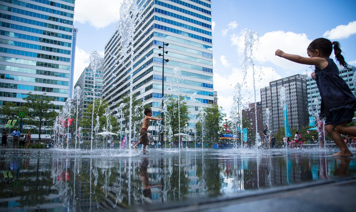 Children play in the fountain at Dilworth Park, surrounded by city buildings, in Philadelphia, Pa., on August 28, 2015, a month before Pope Francis plans to visit the city. Religion News Service photo by Sally Morrow