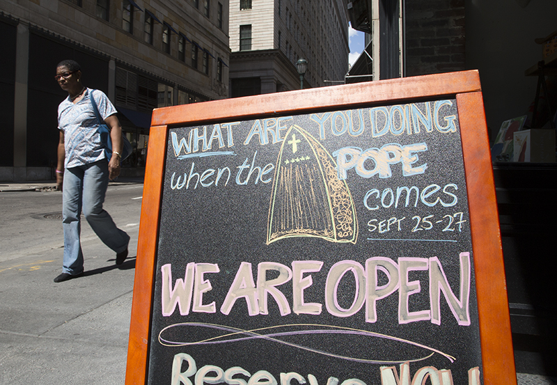 A sign advertises a spa in downtown Philadelphia, Pa. on August 28, 2015, a few weeks before Pope Francis' scheduled trip to the United States. Religion News Service photo by Sally Morrow