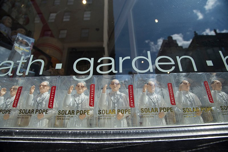 Solar Pope figures are on display in the window of Open House, a shop in downtown Philadelphia, Pa., on August 28, 2015, weeks before Pope Francis' scheduled visit to the United States. Religion News Service photo by Sally Morrow