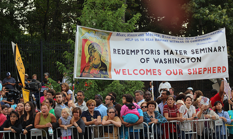 A crowd outside the Vatican Embassy welcomes Pope Francis to the U.S. on Sept. 22, 2015. Religion News Service photo by Adelle M. Banks