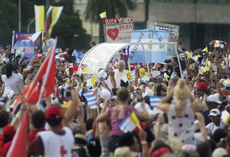 Pope Francis waves upon arriving to give the first mass of his visit to Cuba in Havana's Revolution Square, September 20, 2015. Photo courtesy of Reuters