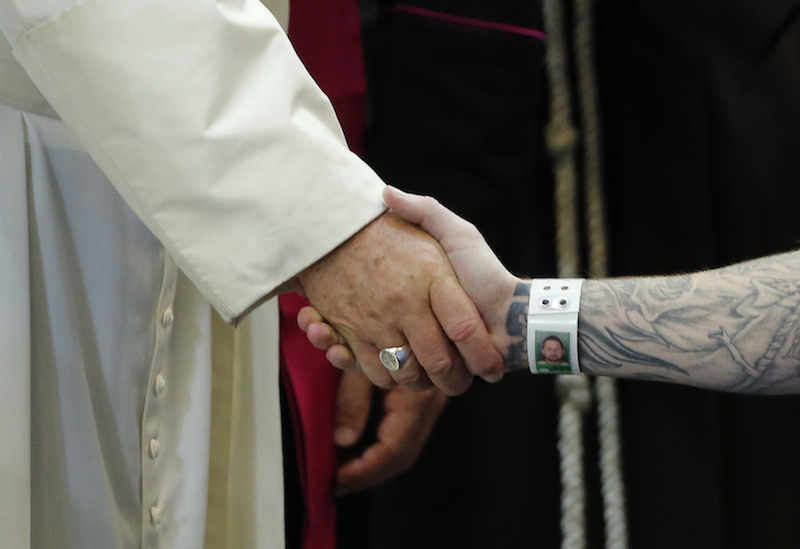 Pope Francis shakes hands with an inmate as he meets with prisoners at Curran-Fromhold Correctional Facility in Philadelphia, September 27, 2015. Photo courtesy of REUTERS/Jonathan Ernst *Editors: This photo may only be republished with RNS-POPE-PRISONERS, originally transmitted on Sept. 27, 2015.