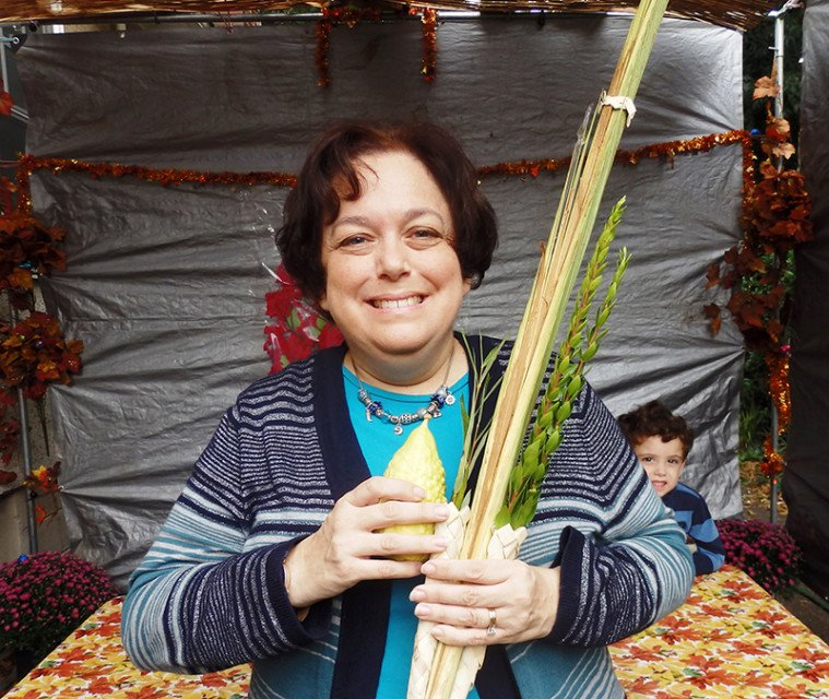 Rabbi Deborah Bodin Cohen and her son Ezra in the family's sukkah in Rockville, Md. Photo courtesy of David Cohen