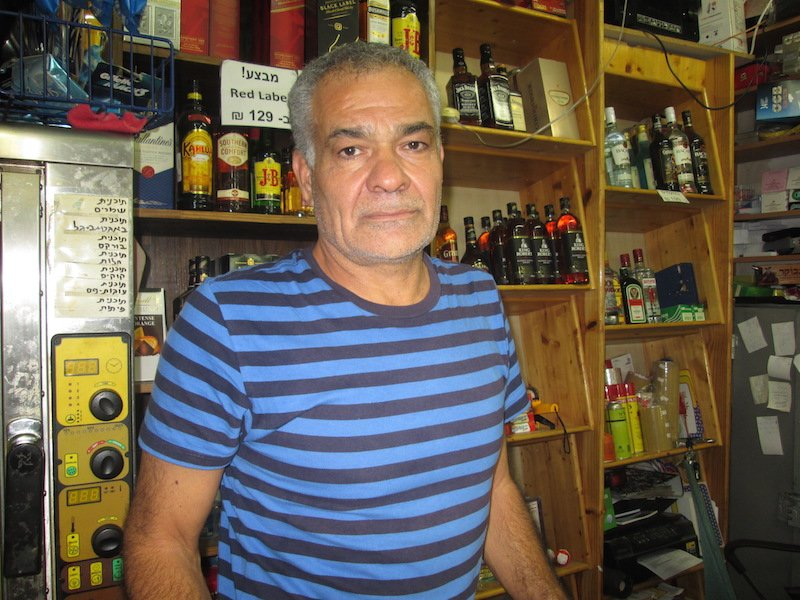 Yossi Cohen, whose downtown Jerusalem convenience store has been operating on the Jewish Sabbath for 20 years, faces fines if he doesn't shutter his store from Friday night-Saturday night. Photo courtesy Michele Chabin