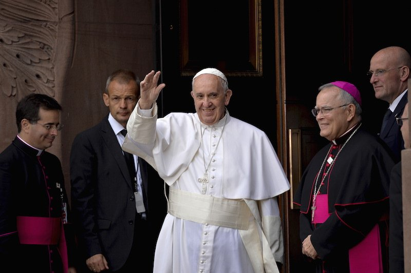 Pope Francis waves to the crowd as he arrives for mass at the Basilica of St. Peter and Paul, in Philadelphia, Pennsylvania, September 26, 2015. Photo courtesy REUTERS/Charles Mostoller