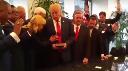 Evangelical pastors lay hands on Donald Trump and pray for him. Screenshot from video
