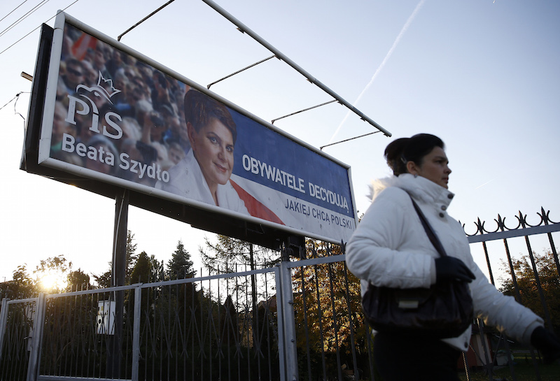 An election banner depicting Law and Justice's (PiS) candidate for Prime Minister Beata Szydlo is seen in Wasaw, Poland October 27, 2015. Polish eurosceptic, conservative opposition Law and Justice party secured a historic win in Sunday's parliamentary election, final results showed on Tuesday, unseating the centrist Civic Platform after an eight-year rule. Photo courtesy REUTERS/Kacper Pempel