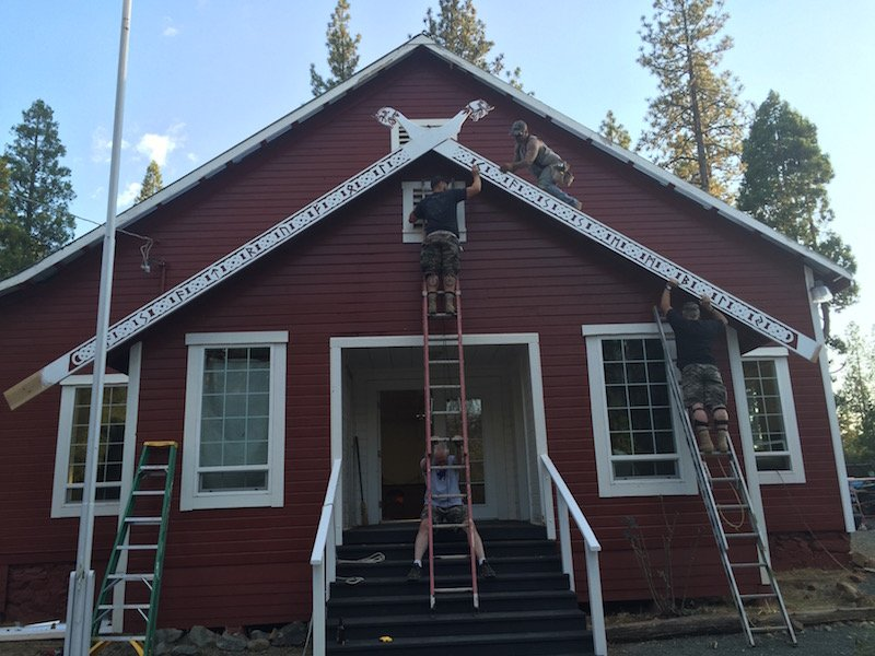 Members of Asatru Folk Assembly raise carved beams with crossed horse heads and Norse runes on their new meeting hall in Northern California. Photo courtesy of Bradley Taylor-Hicks