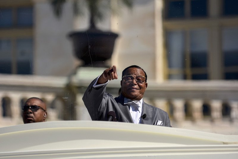 "Nation of Islam leader Louis Farrakhan speaks from behind a layer of glass on the steps of the U.S. Capitol at a rally billed as ""Justice or Else"" to mark the 20th anniversary of the Million Man March on the National Mall in Washington October 10, 2015. The original Million Man March took place on October 16, 1995. Photo courtesy REUTERS/James Lawler Duggan"
