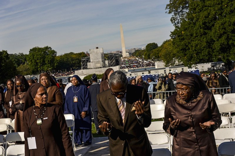 "Attendees are led in prayer at a rally convened by Nation of Islam leader Louis Farrakhan and billed as ""Justice or Else"" to mark the 20th anniversary of the Million Man March on the National Mall in Washington October 10, 2015. The original Million Man March took place on October 16, 1995. Photo courtesy REUTERS/James Lawler Duggan"