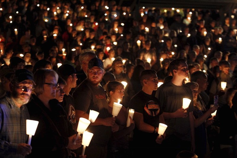 People take part in candlelight vigil following a mass shooting at Umpqua Community College in Roseburg, Oregon October 1, 2015. A gunman opened fire at a community college in southwest Oregon on Thursday, killing nine people and wounding seven others before police shot him to death, authorities said, in the latest mass killing to rock an American campus. Photo courtesy REUTERS/Steve Dipaola