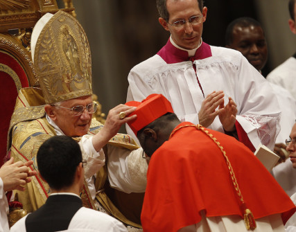 New cardinal Robert Sarah of Guinea receives the red biretta, a four-cornered red hat, from Pope Benedict XVI during the Consistory ceremony in Saint Peter's Basilica at the Vatican November 20, 2010. Photo courtesy REUTERS/Tony Gentile