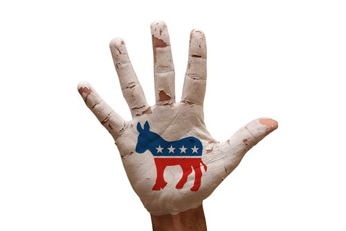 A palm painted with the U.S. democratic party symbol.