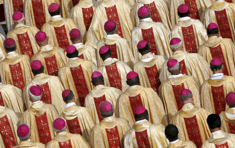 Bishops are seen in attendance as Pope Francis leads the mass for a canonization in Saint Peter's Square at the Vatican on October 18, 2015. Photo courtesy of REUTERS/Alessandro Bianchi *Editors: This photo may only be republished with RNS-BISHOPS-SYNOD, originally transmitted on Oct. 19, 2015.