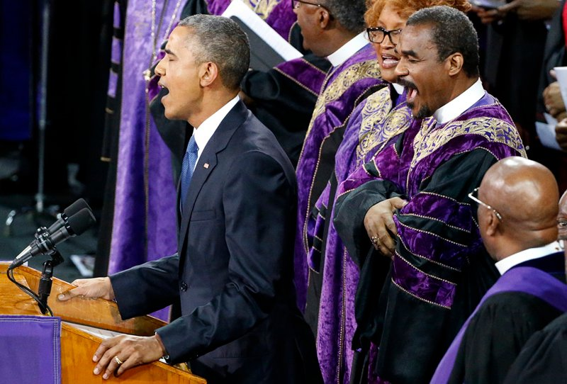 "U.S. President Barack Obama leads mourners in singing the song ""Amazing Grace"" as he delivers a eulogy in honor of the Rev. Clementa Pinckney during funeral services for Pinckney in Charleston, South Carolina on June 26, 2015. Pinckney is one of nine victims of a mass shooting at the Emanuel African Methodist Episcopal Church. Photo courtesy of REUTERS/Jonathan Ernst *Editors: This photo may only be republished with RNS-GRACE-BOOK, originally transmitted on Oct. 28, 2015."