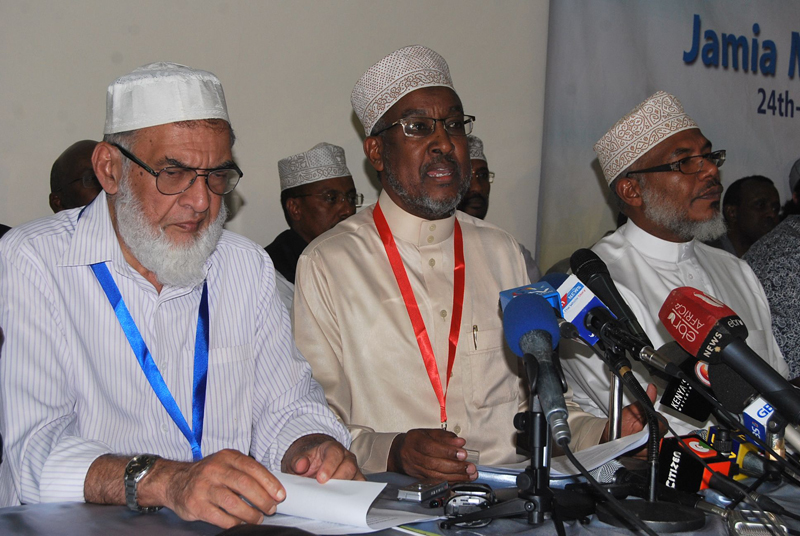 Left to right, Farouk Adamu, deputy chairperson of Nairobi's Jamia Mosque Committee, Abdullahi Abdi, chairperson of National Muslim Leaders Forum (NAMLEF) and Abdilatiff Essajee, the Jamia Mosque Committee treasurer speak during a press conference with other Muslim leaders on October 25, 2015. Kenyan Muslim leaders will head the rehabilitation and re-integration of returning nationals who have been fighting for Al-Shabaab in Somalia. Religion News Service photo by Fredrick Nzwili