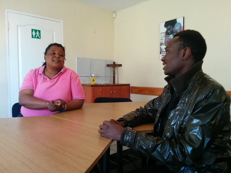 Bulelwa Panda and Prince January chat in the iThemba Lam Center's meeting room before an evening Grace Community Church service in Manenberg, South Africa on October 6, 2015. Religion News Service photo by Brian Pellot