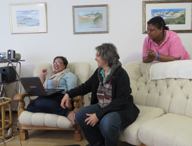 Michelle Boonzaaier, Judith Kontzé and Bulelwa Panda engage in strategic planning at the monthly Inclusive and Affirming Ministries staff meeting in Durbanville, South Africa on October 5, 2015. Religion News Service photo by Brian Pellot