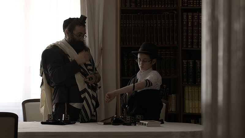"""A scene from """"Episode 1: The Seekers"""" in Oprah Winfrey's new """"Belief"""" series. In Budapest, Hungary, 13-yr-old Mendel Hurwitz prepares for his Bar Mitzvah, the Jewish transformation from adolescence to adulthood. Mendel's synagogue in Budapest once faced extinction, and this tiny population of Jews are struggling to keep their culture alive. Photo courtesy of Harpo, Inc."""