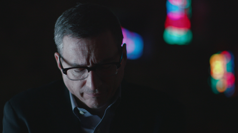 "Rob Schenck prays in a church during a scene from ""The Armor of LIght."" Photo by Jeff Hutchens, courtesy of Fork Films"