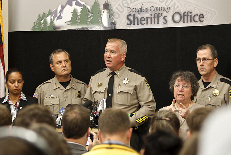 Douglas County Sheriff John Hanlin, center, speaks at a news conference in Roseburg, Oregon on October 2, 2015. Chris Harper-Mercer, the man killed by police on Thursday after he fatally shot nine people at the southern Oregon community college was a shy, awkward 26-year-old fascinated with shootings, according to neighbors, a person who knew him, news reports and his own social media postings. Photo courtesy of REUTERS/Steve Dipaola *Editors: This photo may only be republished with RNS-SINGH-COLUMN, originally transmitted on Oct. 5, 2015.
