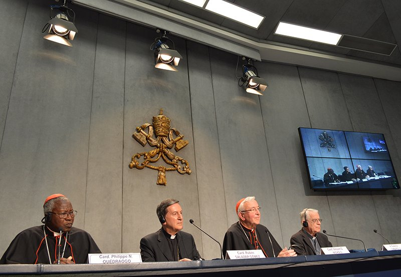Left to right, Cardinal Philippe Ouedraogo, Cardinal Ruben Salazar Gomez, Cardinal Vincent Nichols, and Father Federico Lombardi, during an intense, three-week Vatican summit to debate church teachings and the modern family, at the Vatican on Oct. 14, 2015. Religion News Service photo by Rosie Scammell
