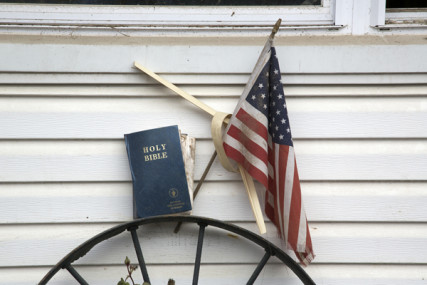 (RNS10-jan15) Flag and Bible in front of a home impacted by Hurricane Sandy on Staten Island, NY. Recovery work is being done by Volunteers in Mission through the New York Annual Conference, United Methodist Church. For use with RNS-UMC-SANDY, transmitted on January 15, 2013, RNS photo by Arthur McClanahan/Iowa Annual United Methodist Conference.