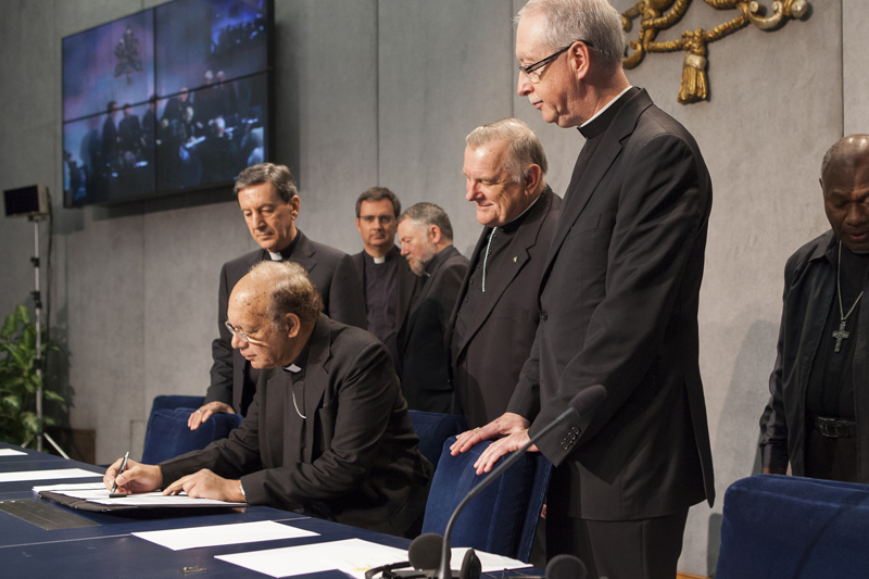 Cardinal Oswald Gracias, center front, president of the Federation of Asian Bishops' Conferences, signs the climate change appeal on Oct. 26, 2015 at the Vatican. Photo courtesy of CIDSE