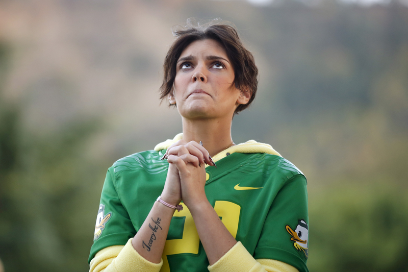 Brittany Gaddis prays during a candlelight vigil for victims of the Umpqua Community College shooting, in Winston, Oregon, United States, on October 3, 2015. The gunman who killed his English professor and eight others at an Oregon community college committed suicide after a shootout with police who were on the scene within five minutes and exchanged fire with him almost immediately, authorities said. Photo courtesy of REUTERS/Lucy Nicholson *Editors: This photo may only be republished with RNS-WAX-COLUMN, originally transmitted on Oct. 5, 2015.