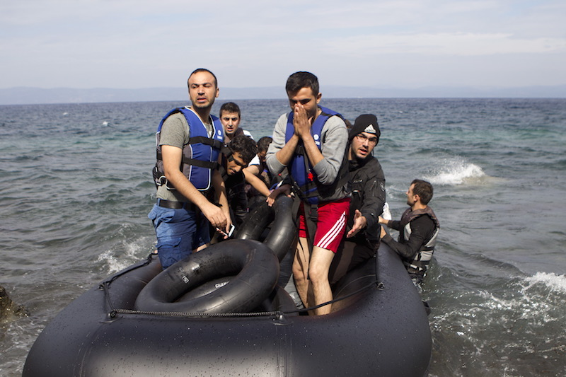 Afghan refugees arrive on a dinghy on the Greek island of Lesbos, after crossing a part of the Aegean Sea from the Turkish coast, on Oct. 8, 2015. Refugee and migrant arrivals to Greece this year will soon reach 400,000, according to the UN Refugee Agency. Photo courtesy REUTERS/Dimitris Michalakis