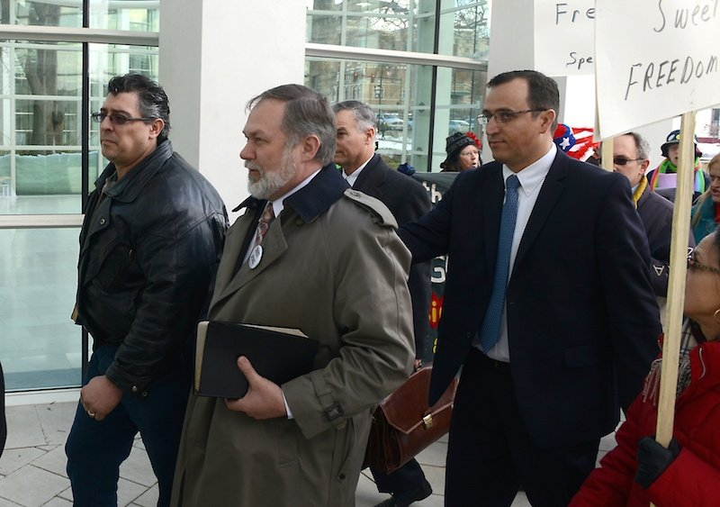 Pastor Scott Lively (in beard and trench coat) shown arriving at U.S. District Court in Springfield, Mass., for a hearing in the crimes-against-humanity case filed against him by gay and human rights organizations. Photo courtesy The Republican/ John Suchocki