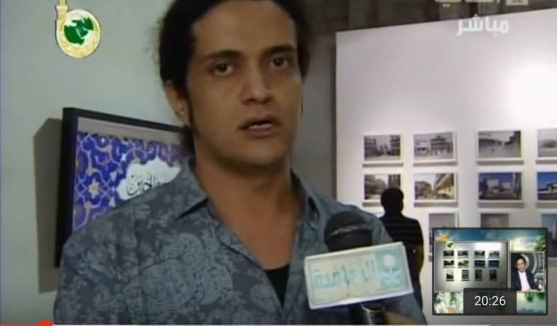 Poet and artist Ashraf Fayadh is interviewed on the Saudi TV Culture Channel in March 2013. Courtesy of YouTube.