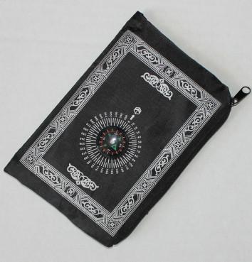 Pocket prayer mat with compass.