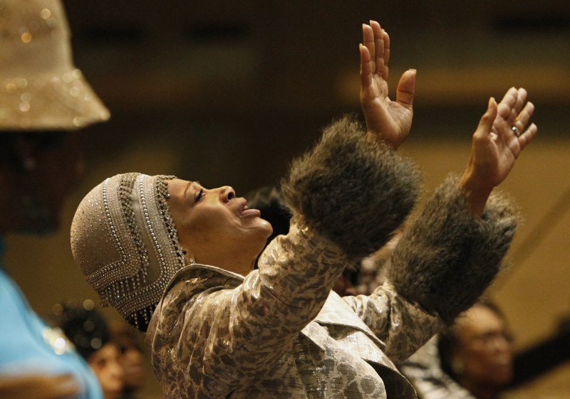 Pamela Pittman, of Oak Park, Ill., prays during the noon church service on Thursday, Nov. 5, 2015, at the Church of God in Christ annual convocation at America's Center. The convocation continues through Sunday. Photo by J.B. Forbes, St. Louis Post-Dispatch.