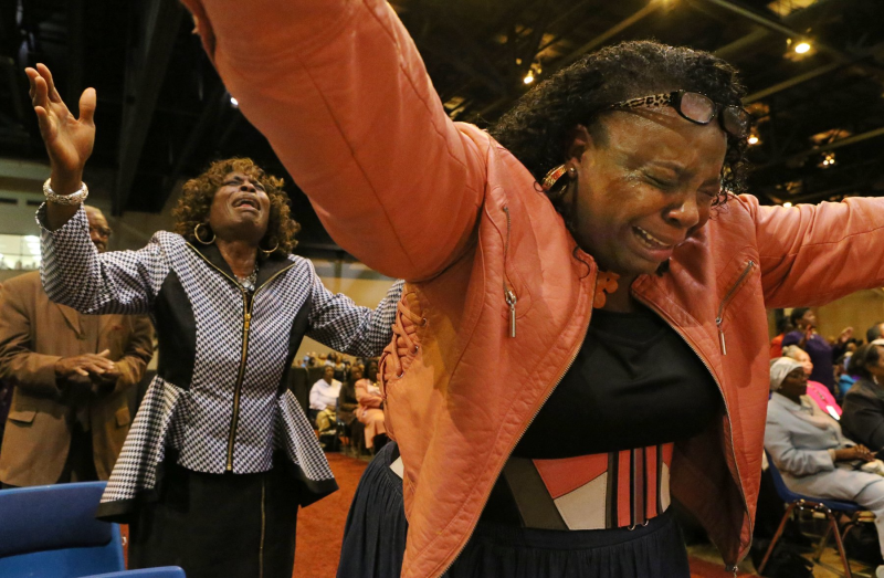 Carolyn Robinson, (left) from Buffalo, New York, and Marva Chaney from Philadelphia, become emotional during the noon church service on Thursday, Nov. 5, 2015, at the Church of God in Christ annual convocation at America's Center. The convocation continues through Sunday. Photo by J.B. Forbes, St. Louis Post-Dispatch.