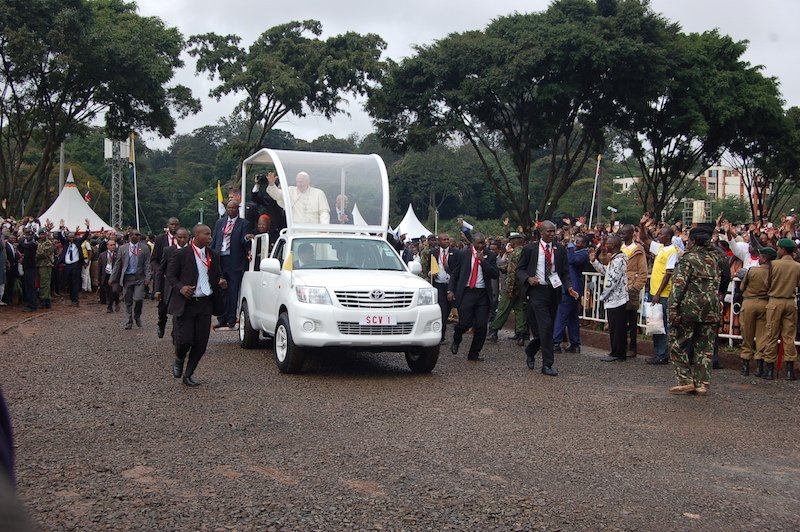 Pope Francis waves as he arrives at the University of Nairobi grounds for the Mass. RNS photo by Fredrick Nzwili